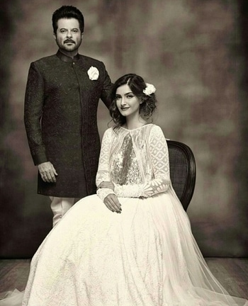 Father- Daughter duo Anil Kapoor and Sonam Kapoor pose for the Manish Malhotra couture
