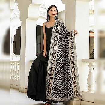 "NEW ARRIVAL  Black Embellished Dupatta suit (Full-Stitch) Top Fabric:- Tapeta Top Colour:- Black Top Length:- 36"" Top Size:- 44"" Neck:- 6"" Plazzo Fabric:- Tapeta Plazzo Colour:- Black Plazzo Length:- 42"" Plazzo Size:- 44"" PlazzoFlair:- 2.5 mtr Dupatta Fabric:- 60gm (2.25mtr) Dupatta Colour:- Black Dupatta Work:- Zari Embroidery Work"