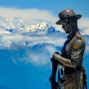 Gorkha Memorial, Batasia Loop, Darjeeling, India.  This War Memorial, built at the centre of Batasia Loop, which in itself is an engineering marvel, is created to honour and serve as a memorial for the Gorkha soldiers of Darjeeling who sacrificed their lives in various operations and wars after India's independence.  This 9 foot statue of a Gorkha Soldier is built next to a cenotaph which carries the roll of honour of the soldiers who died along with the dates.  One can get a 360 degree view of Darjeeling from here as well as of the snow covered peaks of Eastern Himalayas.  #travel #gorkha #memorial #warmemorial #himalayas #batasialoop #darjeeling #indiaclicks #incredibleindia #india #indianblogger #traveler #travelblogger #potd #photography #indiantraveler #wanderlust #_soi #beautifulplaces #explore #picoftheday #bestoftheday #indiatravelgram #mumbaiblogger #traveldiaries #sky #mountains #travelstoke