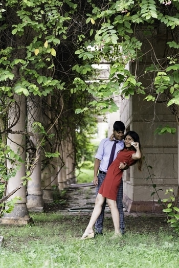Gyan Bhatt and Stuti Kumar posing for the couple photoshoot wearing a beautiful red one piece with white footwear and guys wearing crisp oxford skyblue shirt with dark blue tie creating a colour contrast with green check trouser and tan boots. #croptop  #croptoplove  #white  #rayban  #shades  #blue #denim  #denimjeans  #denimshorts  #green  #shirts  #teen #teenfashion  #trendalert  #trendalert2017