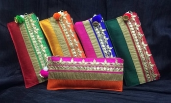Traditionally Trendy #indianwedings  #wedding  #designer  #gift  Make your wedding #specialday For your guest with #clutch  #pouch elegant #envelope in #beautiful  colourful #stylishwear  #weddingtheme #customized #giftingideas  designed by #rangraag Follow is on instagram @rang.raag To order what's app us at 9820355101 #bulk  quantity available