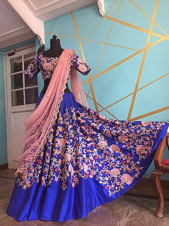 Another masterpiece from our production house standing elegant and beautiful!  #archithanarayanamofficial #masterpiece #handcrafted #lehenga #embellished #offshoulder #elegant #beautiful #classic #eveningwear #bridalcouture #wedding #attire #trousseau  #reception #sangeet #royalblue