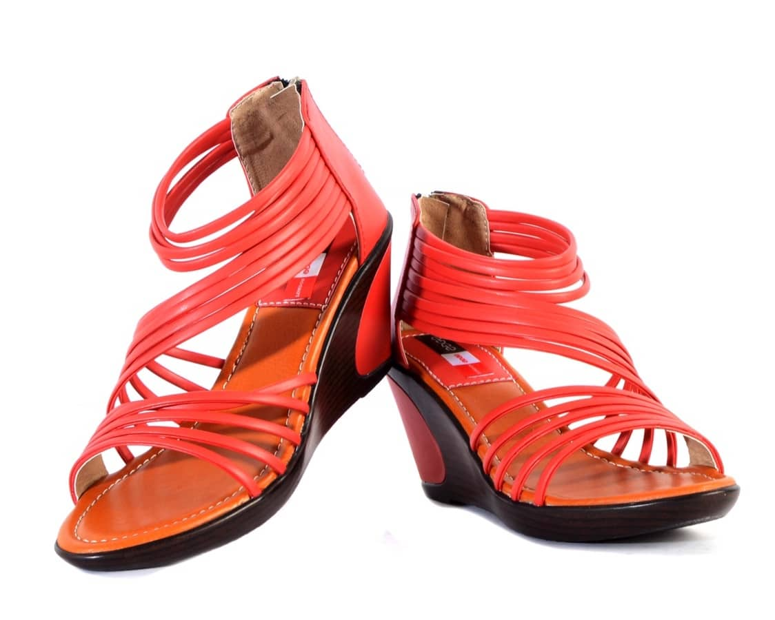 A pair of red wedges,has a zip closure and mid-top styling. Synthetic upper with a multiple strap, has a heel collar. Cushioned footbed. With a design that will surely perk up your appearance,this pair of wedges is the perfect pick to flaunt your stylish look. Place your order soon.