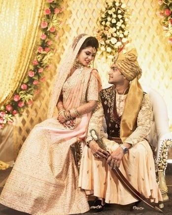 The queen & the king absolutely cannot take their eyes off of each other.  Shop for such majestic outfits from WedLista.com.  Shot by: @plushaffairs  #WedLista #FashionForWeddings
