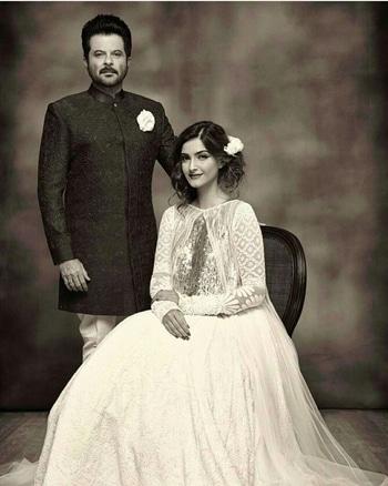 Anil Kapoor and Sonam Kapoor posing  in Manish Malhotra outfits