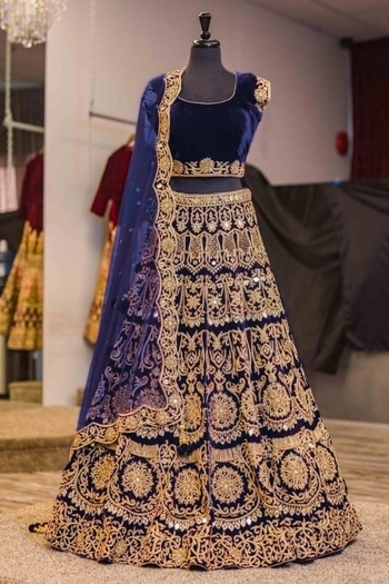 New velvet lengha choli with zari embroidery and mirror work all over. It is paired with a Navy Blue net cutwork dupatta with mirror work.   Price - ₹4300/- (INR)  Title: Navy Blue machine embroidery lehenga choli with mirror work. Size: Free Color: Navy Blue Fabric: Velvet Type: Embroidered Neck Type: Round Neck Sleeve Type: Short Sleeve #lehengas
