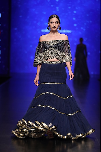 Featuring a #blue off-shoulder #cape paired with a silk bustier & net tiered #skirt by Rabani & Rakha : https://www.indiancultr.com/designers/rabani-rakha.html #love #beautiful #India #IncredibleIndia #wow #amazing #artisan #want #neednow #inspiration #Indian #traditional #makeinindia #instalike #instadaily #photooftheday #follow #repost #awesome #style #shoppingonline #designer #runway #new #couture