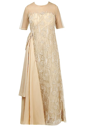 A beige #gown by Divya Kanakia featuring a layered drape pattern and sheer neckline with cutdana #embroidery: https://www.indiancultr.com/designers/divya-kanakia.html?p=2 #love #beautiful #India #IncredibleIndia #wow #amazing #artisan #want #neednow #inspiration #Indian #traditional #makeinindia #instalike #instadaily #photooftheday #follow #repost #awesome #style #shoppingonline #designer