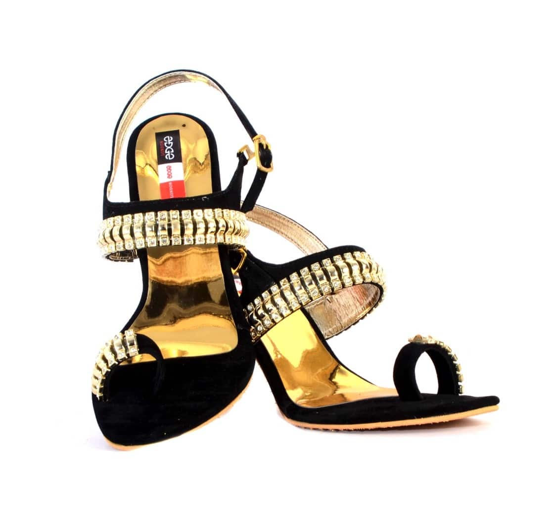 A pair of black heels with a separate toe holder with Stone Studded detailing also on midfoot strap,has a ankle loop with golden buckle to enhance the look Pair it with any embellished saree with classy clutch