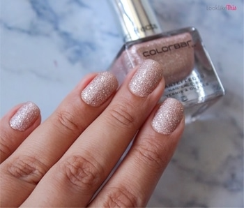 Since so many of you asked, here it is💁🏻 This is the @lovecolorbar ArtEffects Nail Lacquer in the shade Love Boat. It's a really subtle pink and is absolutely perfect for this festive season. It has a textured finish, and even the glitter bits pop through really well from this. It also claims to be non-yellowing which is actually true. Cooking and eating make my right hand nails yellow all the time and it hasn't happened with this polish😅 It also passes the hair wash test - 5th day today and no chips 😍 I purchased this from #Beautiful in #Lokhandwala. Priced at Rs.325✨ . . . . . #nails #manicure #nailpolish #nailstagram #nailinstagram #nailfashion #nailaddict #nailsofinstagram #nailsoftheday #nailstoinspire #nailswag #nailporn #indianblogger #indianbloggers #mumbaiblogger #mumbaibloggers #indianbeautyblogger #indianmakeupblogger #bbloggers #beautybloggers #bblogger  #beautyjunkie #beautyaddict #beautylover #beautycommunity #beautylover #notd #nailpolishjunkie