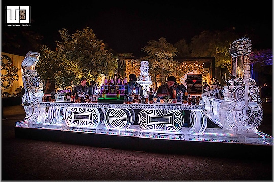 What better way to chill your champagne than to encase it in ice? Now that's one 'cool' champagne toast! Molecular mixology and bars made out of ice and ice sculptures are trending this wedding season and are a must have at your wedding!