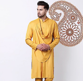 Still continuing to stand at the forefront of men's fashion; this Stylish Shawl White Men's Kurta by I Know is edgy, elegant and masculine with focus on attention to detail. This Rayon Kurta is tailored in band collar with white and gold buttons embelished on the placket and stylized with a drape which runs like a shawl around the neck. Team it up with same colored White Churidar by I Know for the best man look.  Shop Link in Bio  #IKnowCoverMen #CowlNeckKurta
