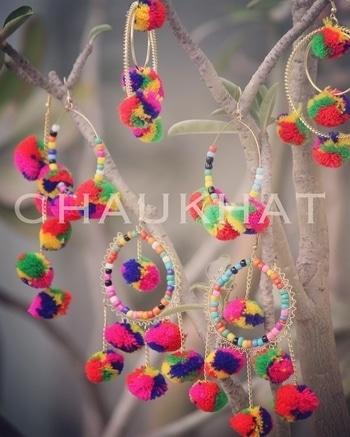 This Holi celebrate the colour of love with CHAUKHAT accessory! #pompom #earrings#pompomjewellery #holi #bridetobe #haldi #mehendi #jewelry_shouts #wedmegoid #creativeweddimgs #indianstreetfashion #colourful