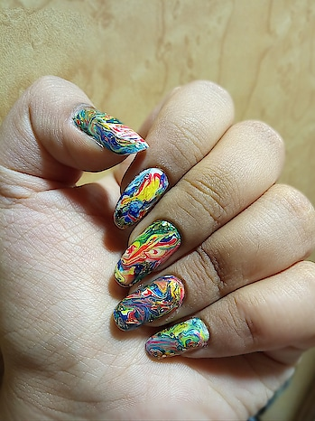 I tried the dry marble nailart...here this design contains only four colours- white, royal blue, red, lemon yellow... . . . . . #nail-designs #nailart #featureme #lovenails  #drywatermarble #prettynails #nailartist #nailsarelife #goodnails #manicurednails