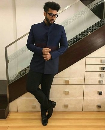 The very dapper Arjun Kapoor makes a chic style statement by Manish Malhotra Label in a Bandhgala textured with slim pants and shoes at Dior.