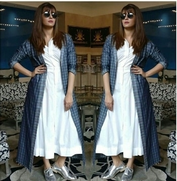 Yay or Nay : Gorgeous Suvreen Chawla in a White dress by Lovebirdsdesins and long blue denim throw by aaylixir for an IPL event in Ranchi...