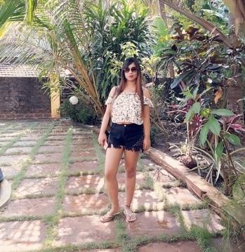 Goa #white cold shoulder top and black jeans short