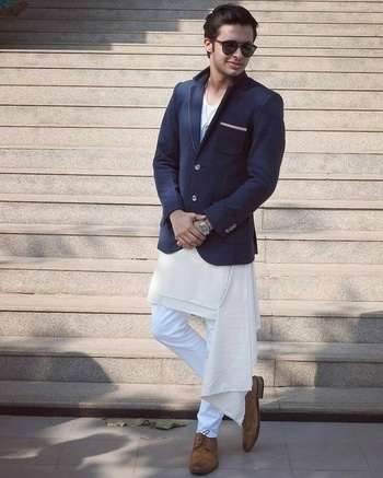 http://bit.ly/2oz3TvW  Need some men's fashion inspiration? We love how he has styled this blazer from Flyrobe with a white kurta. Perfect for a friend's wedding or even a puja!  #SuaveMenRent #Flyrobe