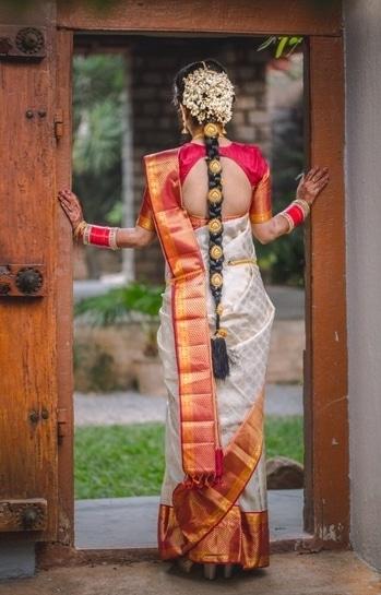 A beautiful South Indian bridal braid. #bridalhairstyle #bridalmua #makeupbynikkineeladri #brides #hair #traditional #bangaloremakeupartist #weddingstyle #flowerhairdo