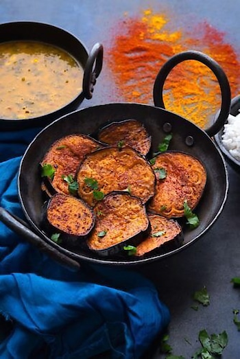 Baingan Bhaja, a #Bengali dish of marinated #eggplant slices pan #fried in mustard oil. PC: cubesnjuliennes.com #food #yumm #eat #delicious #India #incredibleindia #indianfood #foodporn #foodie #chefmode #photooftheday #Bengal #dinner