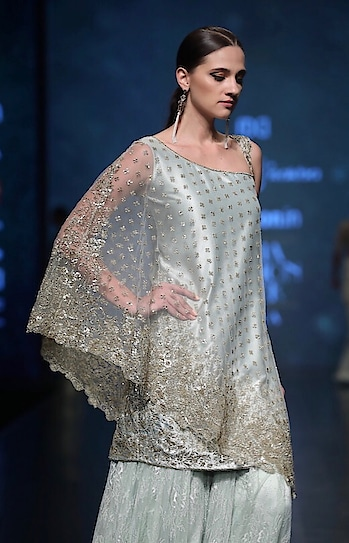 Featuring an #aqua #cape kurta by Rabani & Rakha tailored in satin with sheer embroidered overlay & flared sharara #pants: https://www.indiancultr.com/designers/rabani-rakha #love #beautiful #India #IncredibleIndia #wow #amazing #artisan #want #neednow #inspiration #Indian #traditional #makeinindia #instalike #instadaily #photooftheday #follow #repost #awesome #style #shoppingonline #designer #runway #new #couture