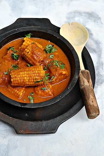Spicy Corn Curry   Corn on the cob curry   Bhutte ki Sabji  Recipe for best gluten free, spicy and easy to make Spicy Corn Curry or Corn on the cob curry or Bhutte ki Sabji! Perfect dish for those rainy monsoon evenings!    Coursemain course,Main Dish  Cuisineindian,north indian  Prep Time15minutesCook Time20minutes  Servings  servings  INGREDIENTS  3corn on the cob  1mediumonionpureed  2largetomatoespureed  2tspghee/oilI use mustard oil  1tspkashmiri chili powder  1tspginger-garlic paste  Salt to taste  For the ground masala  2tbspcoriander seeds  1/2tspmethi seeds  1tspcumin seeds  3Dry red chilies  1tsppoppy seeds  INSTRUCTIONS  Dry roast all the ingredients of masala and grind to a fine powder  Boil corn on the cob in a pressure cooker for 7-10 minutes. Set aside for cooling  In a kadhai or heavy bottom pan, heat ghee/oil. Add Onions and ginger garlic paste and sauté till the onions are golden brown. Sprinkle a little water if onion sticks  Add tomatoes and sauté till the tomatoes leave oil  Add the dry ground masala along with boiled corn and sauté for 5 minutes  Add around 1.5-2 cups of water and cook uncovered for 5-8 minutes till you have a thick gravy.  Serve with hot paranthas or steamed rice