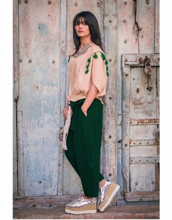 "whatsapp 9930932743  *Ankle length casual pant and top* Pure khadi (100% linen) Embellished with jute laces and tassels   *Pant* M -(26-34), XL-(36-40) *length :* 33"" *Top :* M-36  XL-40   Price  Top 999/- Pant 1250/-"