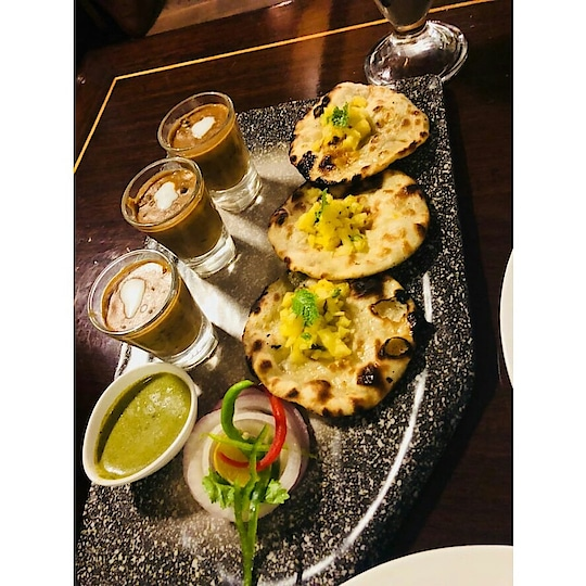 Another dish that caught our attention was Naan &Dal Makhni shots @thechatterhouse I know its too common & boring, right? ...Dal Makhniare served inshotglasses with miniature sized crisp naans(small roti types) topped with fresh pineapple little slices...served with green chutni and garnish with some onion.😋😋 This dish is look so yummy and when i look the dish got waterimg in my mouth..... Its good combination of naal (garnish with pineapple) and makhni shots  Must visit @thechatterhouse  This is place was located in nehru place which is posh and croweded area I like the this place most I want to go again and again i hope you guys go and enjoy it is definitely a good place that you wouldn't regret going to. @thechatterhouse (nehruplace)  #foodie #foodlove #foodporn #shakeshack #foodblogger #foodlife #oreo #oreolove #oreoshake #nutrellaoreoshake #foodieplce #foodlove #foodblogging #foodfav #daalfav #makhnifav #naalfav #garnish #withpineapple #daalmakini #yummy #yummytmmy #yummyfood #yummyyummy