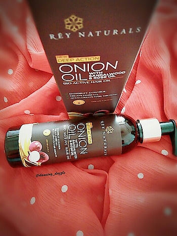 REY NATURALS NEW DEEP ACTION ONION OIL WITH SANDALWOOD AND ROSE OIL | REVIEW  Hello, Hugs and kisses senoritas! 😄😘 How are you all doing? I love using oil on my skin and hair. you will always find different kinds of oils at my dressing table like olive oil, almond oil, lavender oil etc. Olive oil & almond oil is my all time favourite. These days, I'm using a new oilREY NATURALS ONION OIL. This is my second post about Rey naturals Products,Previously I have reviewed their tea tree essentials oil ,so today I will review their Onion oil. Let's see whether you should try it or not.  BENEFITS OF ONION OIL👇 Rich in antibacterial and antifungal properties, the use of onion for hair truly helps keeps hair loss at bay. Here are 10 amazing ways your hair can benefit from using onions:  · They are very good at hair follicle nourishment and help restore lost nutrients to your scalp.  · They are rich in Sulphur, which is known to minimize breakage and thinning.  · They have potentanti-bacterial properties and help fight infections of the scalp. This in turn helps reduce hair fall as scalp infections can cause massive loss of hair.  · They are naturally potent antioxidants, which is why they help reverse the effects of premature greying.  · They can be used to fight dandruff owing to their rich anti-bacterial properties.  This is 15 in One oils and there are 14 Other Extracts inside it Improve Hair Growth & hair fall Control  1. Coconut Oil  2. Sunflower Oil  3. Vitamin E  4. Castor Oil  5. Argan Oil  6. Jojoba Oil  7. Amla Extract  8. Hibiscus Extract  9. Neem Oil  10. Bhringraj Extract  11. Mango Butter  12. Shea Butter  13. Sandalwood Oil  14. Rose Oil  PRICE⏩ 799/-(200ml) but you can get it from Amazon only 369/-  KEY INGREDIENTS👇 Red Onion Extract, Coconut Oil, Sunflower Oil, Vitamin E, Castor Oil, Argan Oil, Jojoba Oil, Amla Extract, Hibiscus Extract, Neem Oil, Bhringraj, Bhrami, Indian Margosa, Mango Butter, Shea Butter, Sandalwood Oil, Rose Oil, Isoamyl Laurate  DIRECTION