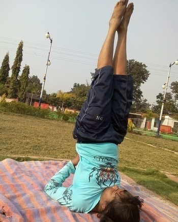 Sarvangasana(Shoulder Stand Pose)  Contraindications: This asana should not be practised by people suffering from enlarged thyroid, liver or spleen, cervical spondylitis, slipped disc, high blood pressure or other heart ailments, weak blood vessels in the eyes, thrombosis or impure blood. It should be avoided during menstruation and advanced stages of pregnancy.  Benefits: By pressing the chest against the chin this asana stimulates the thyroid gland, balancing the circulatory, digestive, reproductive, nervous and endocrine systems. Together with the enriched blood flow to the brain, it also tranquillizes the mind, relieves mental and emotional stress, fear and headaches and helps clear psychological disturbance. The thymus gland is also stimulated, boosting the immune system. Its influence on the parathyroid glands ensures normal development and regeneration of the bones. Sarvangasana is used in yoga therapy for the treatment of asthma, diabetes, colitis, thyroid disorders, impotence, hydrocele, prolapse, menopause, menstrual disorders and leucorrhea. Regular practice helps to prevent cough, cold and flu. #yoga