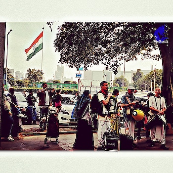 """Connaught Place is the perfect hub to find stories. As I posted in my previous posts on CP, you get to see so many things at one place. I always get fantasized by foreigners who sing Indian songs, esp. religious ones. They were singing """"Hare Rama Hare Krishna"""" and had their attire, vocals and music system in place. Loved listening to them. They were doing this act to raise funds and for the selling of few religious books in the middle of CP. So, whenever you have time, alone or with someone, just head to CP, find your stories or maybe write a new one for yourself... . . . . #cp #connaughtplace #connaught #cannaughtplace #cannaughtplacedelhi #cannaught_place  #relaxed . . . Follow me @medhavista  Follow me @medhavista .  #lifestyleblogger #lifestylebloggerindia #lifestyle #lifestyleblog #lifestyleblogs #lifestyles #Delhiblogger #Delhifashionblogger #Delhilifestyleblogger  #IndianLifestyleBlogger #shot #shotononeplus #shotononeplus5t #shotononeplusfivet #shots #oneplus5tphotography . . . @oneplus_india @oneplus @oneplus_5t @oneplus.photography @oneplus_in"""
