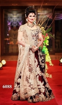 Divyanka Tripathi Lehenga Fabric :- 9000 velvet + net Color :- maroon + beige blouse :- 9000 velvet Peticott :- SANTOON Type :- lehengha-choli Price :- 5000