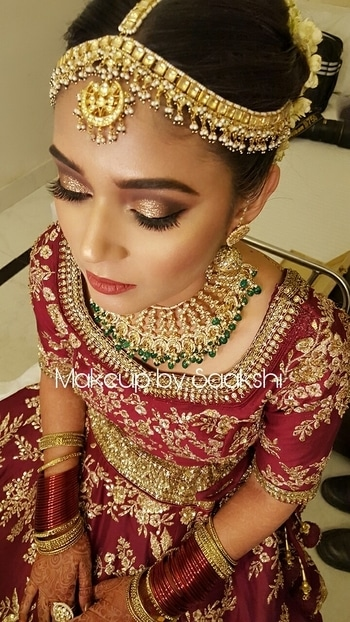 Gorgeous Ankita in Sabyasachi inspired look.. #makeupbysaakshi for bookings contact 9899660145 . . . . . . . . . . . #makeupartist #delhimakeupartist #delhiweddings #muadelhi #mua #makeup #wedding #weddingmakeup #rajasthanibride #followformore #bridalmakeup #bride #makeupforbride #bridalaccessories #bridalhair @reba_khan #smokeyeyes #glittereyes #makeupforeverofficial #hudabeauty #beccacosmetics #eyekandy #smashbox  #bridal