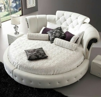 Romantically round bed in a Chesterfield style #fauxleatherbed#homeinteriors
