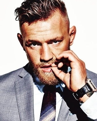 "I'm a fucking pimp, rocking all white Gucci mink, and without me, this whole fucking ship sinks."" The bold UFC champion Conor McGregor isn't known for being understated, either in what he says, or how he says it. But when it comes to his personal style, the Notorious one doesn't need to make a big noise for everyone to stand up and take notice. Whether it's his handmade three-piece David August suits, Louis Vuitton python loafers, of Dita Mach-One sunglasses, everything McGregor wears is delivered with all the balls out braggadocio he can muster. McGregor is by no means the only UFC bruiser bringing some much-needed sartorial flair to the octagon – traditionally a place where style, along with lesser competitors, has gone to die. McGregor displays a level of swag to match his unrivalled swagger – and fighting prowess. As the Irishman himself puts it, ""There's two things I really like to do and that's whoop ass and look good."" #rocknshop  #thevisionaries #likeforlike #ootd #swag #pots #l4l #fit #fitness #formals #men-fashion #beard @rock_n_shop"