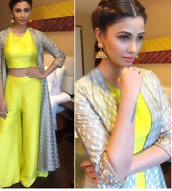 Chic look of Daisy Shah in neon and white.