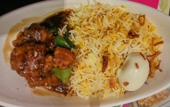 """Have you ever visited @scoop new empire near New market, Kolkata?  If not then I would suggest you to visit it and try this delicious BOWL MEAL named """"BIRYANI WITH CHILLY CHICKEN""""  Believe me guys, if you are a biryani lover, you'll love this dish."""