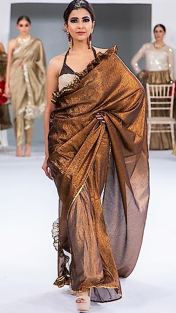 Amazing India fashion week London 2018 , Grand finale fashion show. Metallic woven linen sari with zari  Shine and soft  No fluff of woven  New type of development  Available at emporio or mail us on rinadhaka@hotmail.com  Visit us at our dlf emporio store for our latest collection #rinadhaka #indiafashionweeklondon #grandfinale #london #2018 #dlfemporio #weddings #newcolletion #gold #glitter #indian #bridestyle #shimmer #bridestyle #indianwear #elegant #beautiful #dhotipants #indianbride #luxurydesign #instashop #instalove #buynow #getthelook #beautiful#traditional#lehenga#ethnic love#❤#jdinstituteof fashion