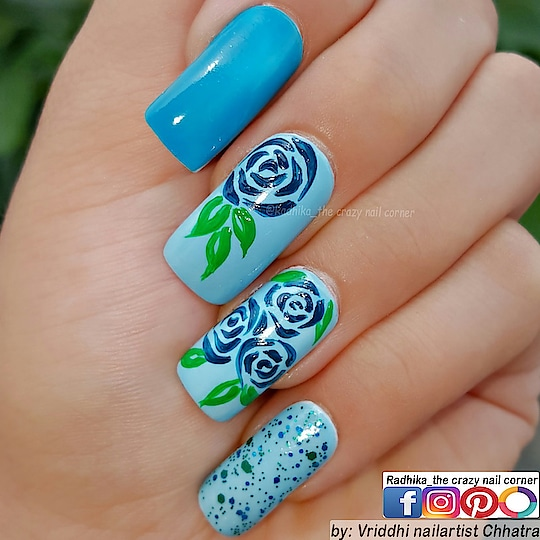 Free Hand Art👐. Floral nails with some Blue. 💙💙💚💙💙 Base: @luronofficial  📸 Clicked with: Samsung Galaxy Note5 📸  #nailartwow #nails2inspire #nailartoohlala   #nailfashion #visualsoflife #hairandfashionaddict  #nailsofinstagram #arts_help #nailsmagazine  #samsungnote5 #roposodaily #roposonails #roposonailart #roposoart #roposocolors #roposolove #roposolovefornails  Enjoy. ☺️