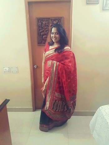 Desi Girl  Since I got married, there are only certain occasions when  I decide to look like a married woman but a wedding in the family is one occassion where I do. This was for a small pooja and being the last one who got married in the family, I was expected to be all dolled up so I decided to wear this beautiful black and red saree gifted to me one of my aunts. I love the combination and how light this was so wven though I was dressed up, I did not feel uncomfortable #halfandhalfsari #ethnicwear #saree #indianwear #desiwear