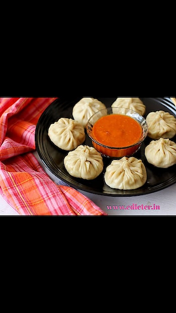 """MOMOS AND RED CHILLI DIP!!  Prepare time:20 minCook:15 minServes:5 Cuisine:tibetan  *IngredientsTomato – 1Garlic8 clovesRed chilies3-4, tear, de-seed and soak in 1/2 cup warm water for 15-20 minsSoy sauce1/4 tsp (optional)Vinegar1 tbspSugar1 tspOil – 1 1/2 tbspsSalt to taste  """"Method for making Momos chutney recipe:-  *Bring 1 1/2 cups of water to a boil, place the tomato in the hot water and cook for 6 mins on high heat.  * Drain the red chilies from the water and add it to the boiling water. Cook on high for 3 mins.   *Turn off the heat. Drain water and cool the tomato and red chilies.  *Heat 1/2 tbsp oil in a pan, add the garlic cloves and saute for a min. Turn off heat and set aside.  *Once the tomato and red chilies reach room temperature, peel the tomato and discard the skin.   *Blend the peeled tomato along with red chilis, roasted garlic, sugar, vinegar, soy sauce, and salt to a smooth paste.  *Add 1/3 cup water for a smooth flowing consistency.  *Heat a tbsp of oil in a pan, add the ground paste and cook on medium heat for 4 mins stirring constantly so that it does not burn. Turn off heat and remove to a serving bowl.  Tips:- *You can use up to 6 red chilies for a fiery chutney.  *I used 3 red chilies for a medium spiced chutney.  *You can omit tomato and increase vinegar by a tbsp.  *If the texture is too runny, mix a tsp of corn flour in little water and add it at Step 4 and keep stirring till it thickens. * You can omit roasting the garlic and blend it along with rest of ingredients.  *I have used small garlic flakes. If using the large sized ones, use 4 garlic flakes.  #momolover #foodbloggerlife #foodporn #fitgirl #nutritiouslife #fitnessblogger  #actorslife #roposofun  #dietplan #dietfood #dietician #lekha   follow us for more details about on diets!!  fitness expert &Dietician"""