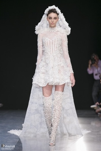 My favorite piece from Paris fashion week. The showstopper for Georges Chakra fall winter. A radical change of a bridal dress into a a combination of the modern and the renaissance eras of a short corset type dress and a hood with a long train made of sheer. And the sheer boots decorated with pearls are something really unique.   #parisfashionweek2017 #georgeschakraofficcial  #couture #parisfashionweek #pariscoutureweek #pariscouture #fashionweek #runway #bridal #showstopper #blog #blogger #fashionblogger #pfw #couture