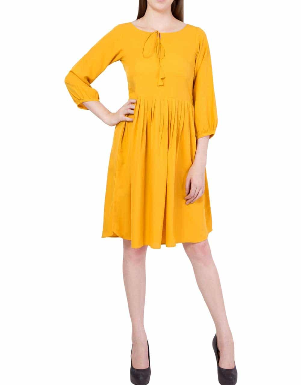 Color of the year, this bright mustard yellow dress is the answer to all your fashion worries. With long bishop sleeves and a gathered skirt, this knee length dress is bound to flatter you. Wear it to a casual day out or a night with friends, you can style it up or down according to your wish. Simbha Women's Yellow Peasant Dress 👉👉 Shop now @ #simbhacreations, contact or whatsapp on 9560184087 #dresses