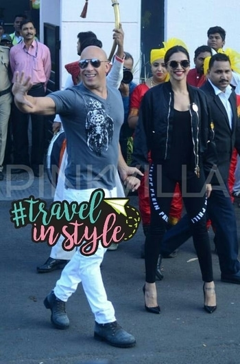 Deepika Padukone and Vin Diesel receive grand welcome at the Mumbai airport! Deepika Padukone is finally back to the bay after attending the grand premiere of her big Hollywood debut xXx: Return of Xander Cage in Mexico City and London. And guess who's accompanied her here? It's none other than her hot co-star Vin Diesel. Vin has come to the country for the film's premiere in the city. Deepika, yesterday posted pictures on her Instagram indicating she will be reaching Mumbai anytime soon. And now the amazing duo has reached here finally. We got our hands on some pictures where Vin received a grand and warm welcome at the Mumbai airport. He looked handsome as ever in a grey T-shirt with white pants. Whereas DP sported an uber cool look wearing a black ganji with leather jacket teamed up with jeggings and pointed heels. She finished her amazing look with a pair of round sunglasses. Both Vin and Deepika were seen walking hand in hand when they received a huge welcome. They were all smiles for the shutterbugs. xXx : Return of Xander Cage is slated to release in India this week on January 14, 2017 a week before its US release. #travelinstyle