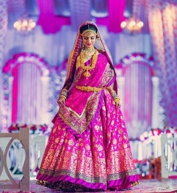 Here comes the bride- All bright & shiny!  Shop from WedLista.com for such lovely bridal lehengas & dazzling temple jewellery.  Shot by: @kartikbhagat  #WedLista #FashionForWeddings