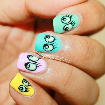 #roposotalenthunt  Did this Eye Mani inspired by @hannah_nails_it .. #hannahinailedit It seems easy but its so difficult to make those eyes 🙈 ..  . . .  #nailpolish #nailpolishaddict #nailpolishlover #nailpolishlove #nailpaints #nailsoftheday #mattenails #nailart #nailartclub #nailartdesign #nailartwow #nailartaddict #nailartist #nailartdesign #lovefornailarts #instanailart #instanailstyle #instanails #nailartblogger #easynailart #nailartlove #nails #nailarts #nailpolish #nailartworld #glossynails #shinynails#eyemani