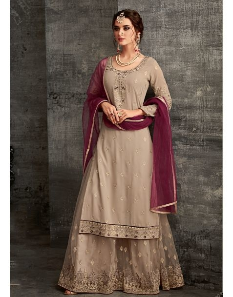 Steal attention  everywhere you go with this #sharara suit available @ www.manndola.com   Grab Up To 65% OFF. Get additional 10% OFF on all orders above $199 using code EXTRA10 & extra 15% OFF on all orders above $299 by using code EXTRA15 !!   Dazzle at your event in this Charming Beige Sharara Style Suit. This Beautiful Suit comes with Outstanding Embroidered Georgette Top with Matching Dyed Santoon Bottom and Inner.And the dyed net dupatta makes dress attractive.  #newarrivals #newlaunch #partywear #sharara #georgette #stonework #style #photography #instamood #instaupload #fashion #indianfashion #ethnic #usa #india #canada #australia #dubai #uae #mauritius #london #uk #shoponlin