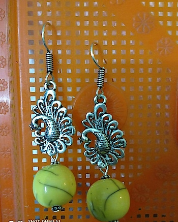 Beads and Charms light weight ear rings.   Status -  Available   PRICE Rs 90/- only plus shipping. Yes you heard it right. SHIPPING CHARGES FOR KOLKATA RS 70. OTHER PLACES RS 100   Team it with your daily wear, western casuals, fusion dress. Best for students and to wear at work.   No COD  No Part Payments  No Return  No Exchange  No Cancellation  We ship across INDIA   #streetstyle #streetstyleindia #earrings #beads #charms #handmadejewelry #desiswag #earringswag #budgetfashion #budgetjewellery #budgetbuy #fastselling #dailyfashion #dailywear #cuteearrings #simpleyetelegant #boho #bohochic #bohochicstyle #homemade #handcraftedjewellery #comment
