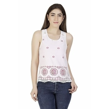 white schiffli embroidered cotton casual top. This top has a hint of fuchsia underneath making it a contrasting combination. #white #casual #women-fashion #cotton #love #delhi #sleevelesstop #embroidered