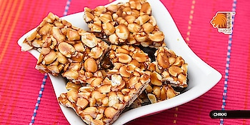 #Chikki is an addictive, easy-to-make treat. It is a popular snack made of groundnuts, sesame seeds and puffed rice in melted jiggery. Gorge on them in winters to keep your body warm. #GujaratTourism #WinterSpecial #EnergyBar